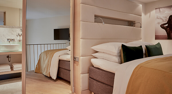 Split level loft suite at Park Hotel Amsterdam with bed and glass