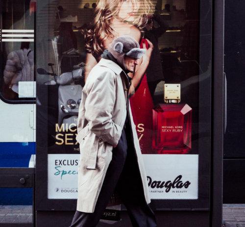 Cristian Geelen Man walking tramstop advertisement